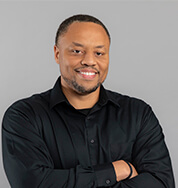 DG Employee wear a black shirt, smiling